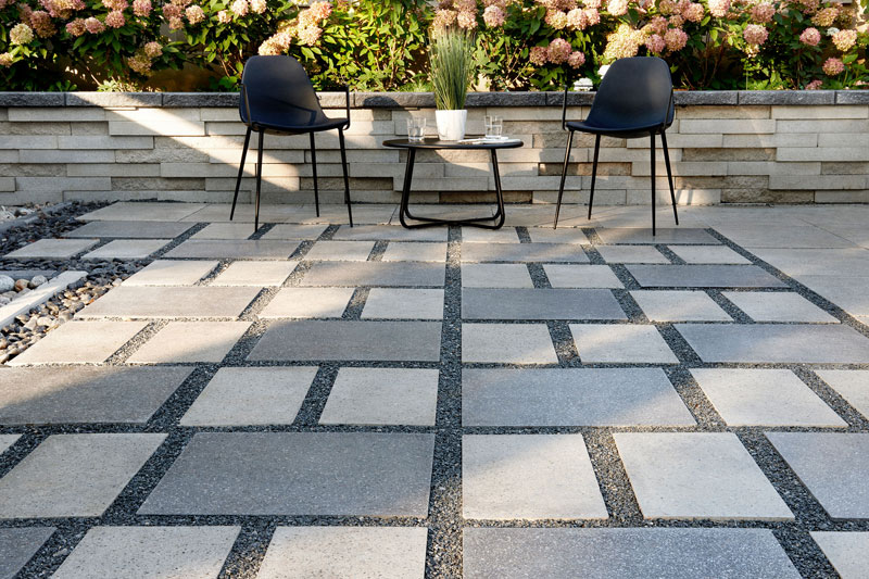 Bring an interesting pattern to your outdoor patio with slabs of contrasting colors and a subtly polished texture. Then play the pattern up the walls ... & Patios | Techo-Bloc